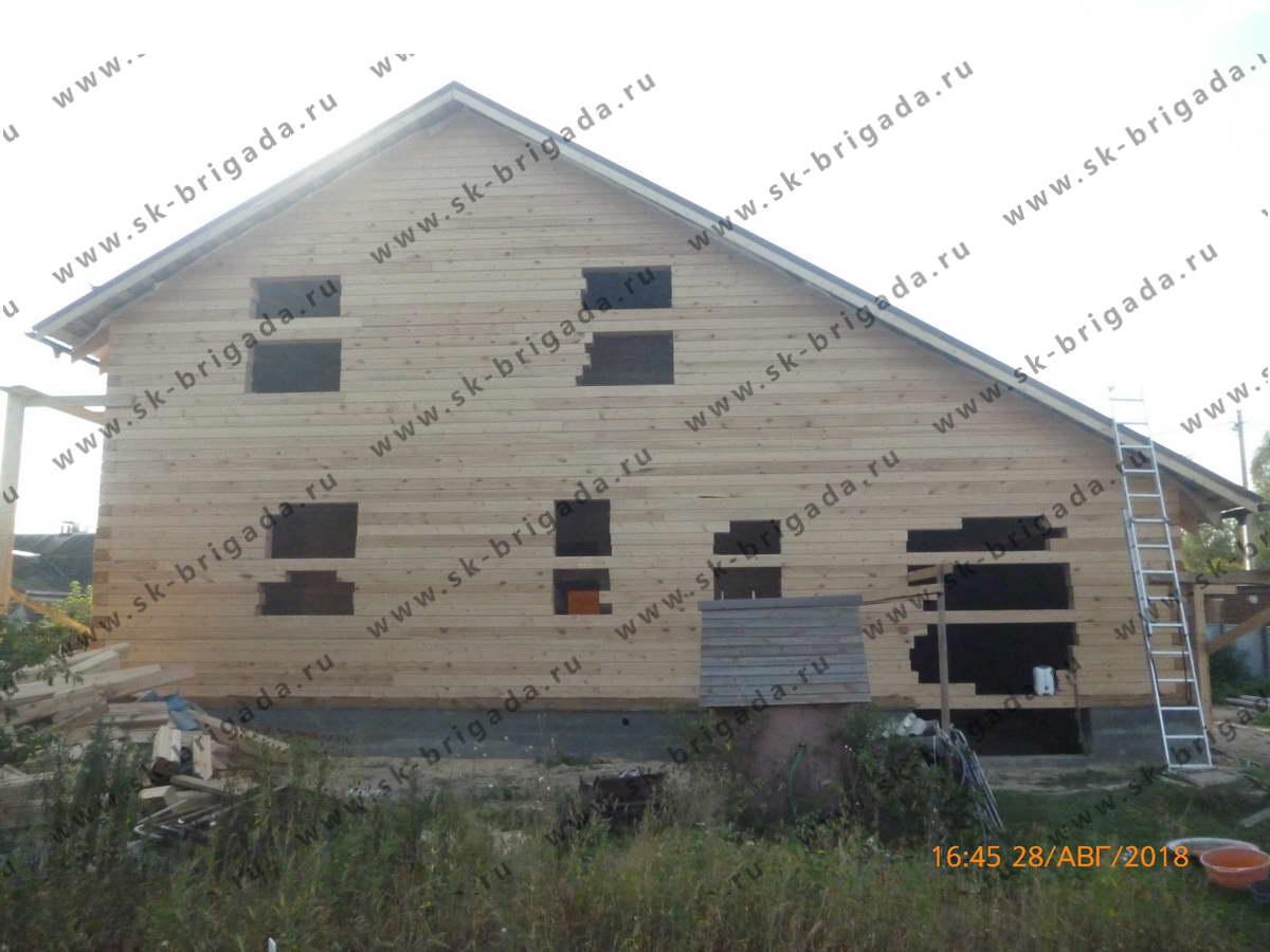 деревянный дом с гаражом из профилированного бруса