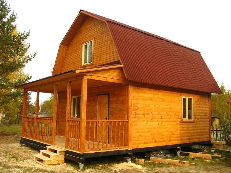 Дом из бруса с окнами и дверьми